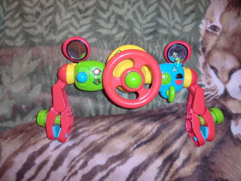 Активная игрушка на коляску