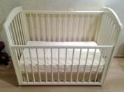 Детская кровать с механизмом качания
